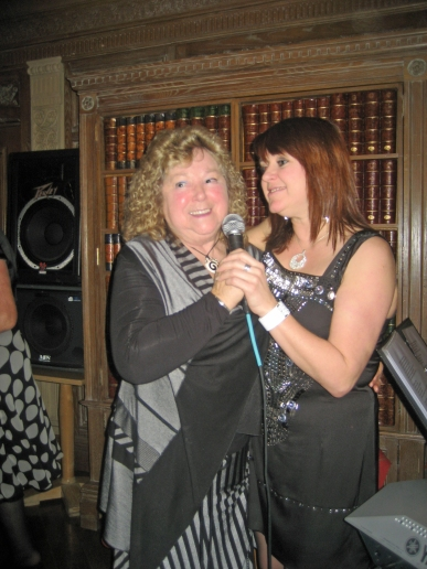 June and Carole ...singing at the Toby one Christmas..